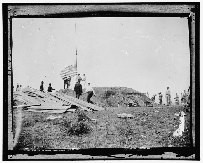 Hoisting the flag at Guantanamo, June 12, 1898 - U.S. Library of Congress