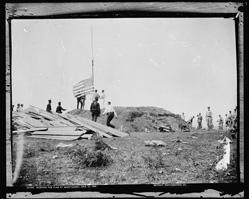Hoisting flag at Guantanamo, circa 1898