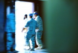Guantánamo Bay, Cuba. Oct. 24, 2011. Guards at Joint Task Force compound move a man within the detention center. Photo courtesy of Joint Task Force.