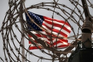 An American flag flies over the detention centers at Camp Delta. Bill O'Leary / The Washington Post
