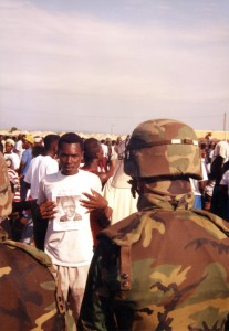 A Haitian refugee and US soldier meet at the holding camps at Guantánamo. Photo courtesy of Merrill Smith.