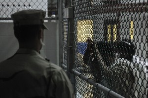 Navy sailor guards Guantanamo Bay detainees. Photo courtesy of Department of Defense.