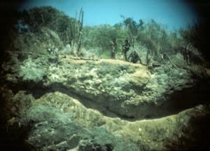 Three Cuban militia thru binoculars at Kittery boundary