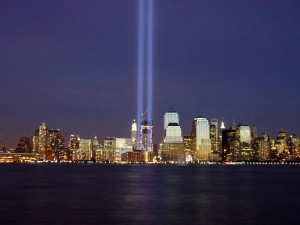 Two beams of light represent the former Twin Towers of the World Trade Center during the 2004 memorial of the September 11, 2001 attacks. Photo by Derek Jensen